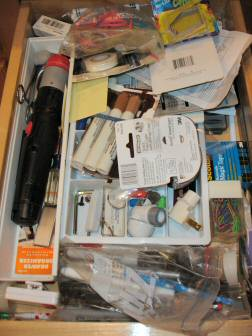 Junk drawer before