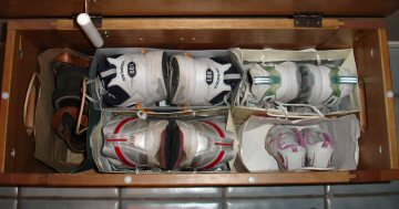 Shoes organized in bench with bags