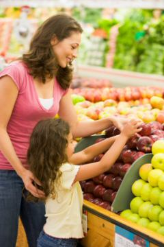 mom and daughter grocery shopping
